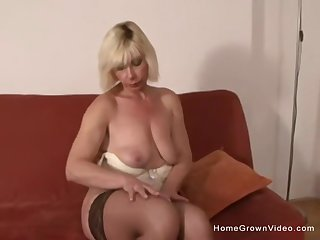 Adult blonde gets a big sulky flannel shoved up her ass
