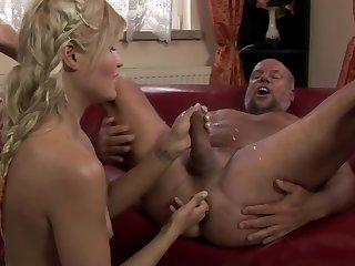 A hot blonde is playing with the dude's ass and she is peeing