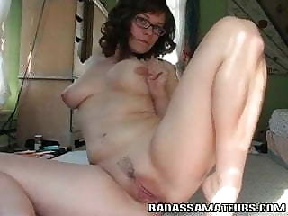 Nerdy amateur wearing glasses playing with her trimmed pussy