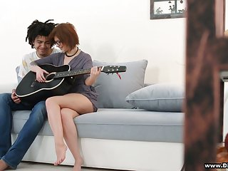 Shy red head in glasses Rebecca Rainbow is fucked by handsome guitar teacher