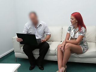 Redhead fucked on the desk