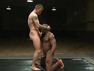 Muscular gay man fucks black dude in the ass