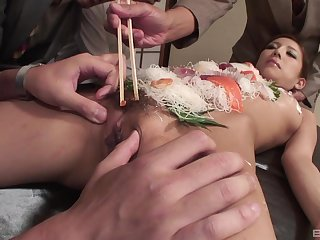 Japanese food fetish during group sex with a slim slave girl