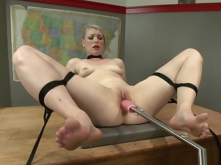 Strapped blonde is machine fucked
