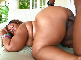 Fuck a chubby ebony and jizz those impressive tits