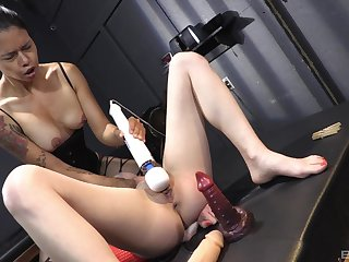 Aroused females use toys in dirty scenes of femdom