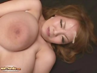 Asian bitch with massive tits got tied up and covered with fresh cum from many cocks