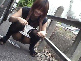 Kinky Japanese girlfriend Yuzuki Hatano loves pissing in public