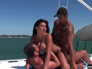 Tanned people are having steamy group sex on a yacht, in the middle of the day