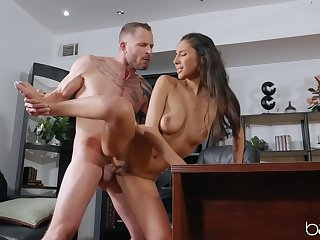 Hard sex by the desk with a slim babe in love with the dick
