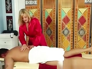 Hot Blonde Masseuse Rubbing Down Client