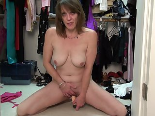 Amateur blonde mature MILF Mimi S. strips in a dressing room