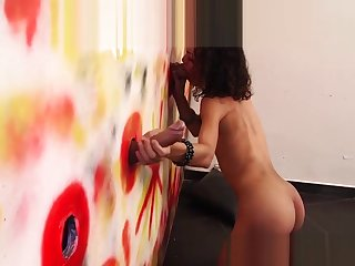 Sexy shemale Bella Rosari takes two dicks in a gloryhole
