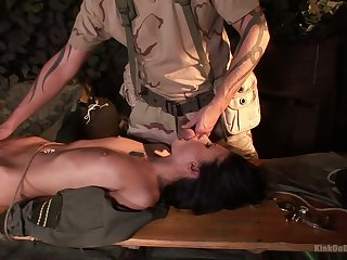 Svelte submissive army bitch Lulu is treated in a kinky way by soldier