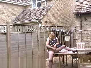 Spying On The Slut Wife Neighbour Wearing Blue Pantyhose In Her Garden