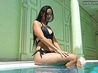 Charming beauty Andriena De Luxe tickles her clit and swims in sexy way