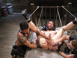 One guy tied up and tortured by two gay dudes in a threesome