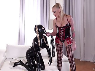 Costumed and kinky lesbian Lucy Latex enjoys amazing sex  with a girl