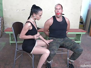 Mistress gives a tugjob and blowjob to tied up submissive Marcel Lee